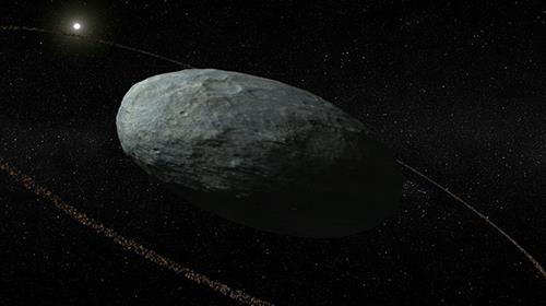 This handout photo released by Nature shows an artistic view of Haumea and its ring system with correct proportions for the main body and the ring