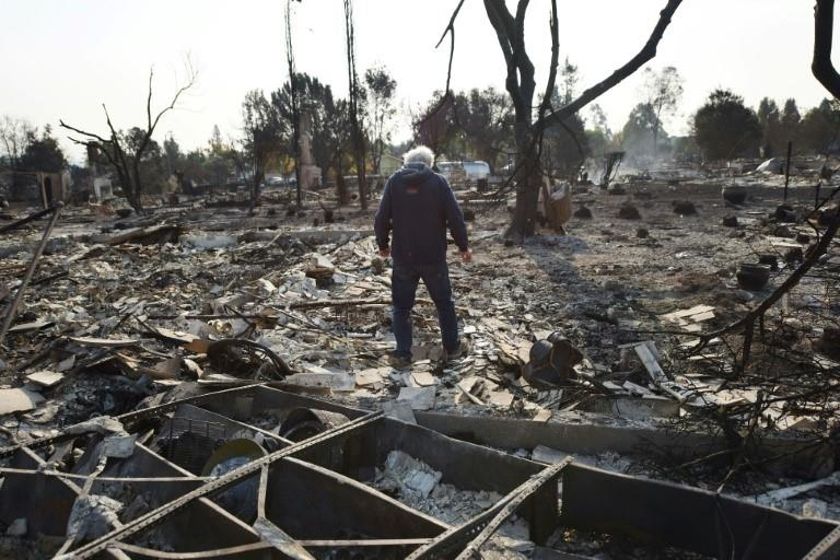 Phil Rush looks at the remains of his home destroyed by fire in Santa Rosa, California