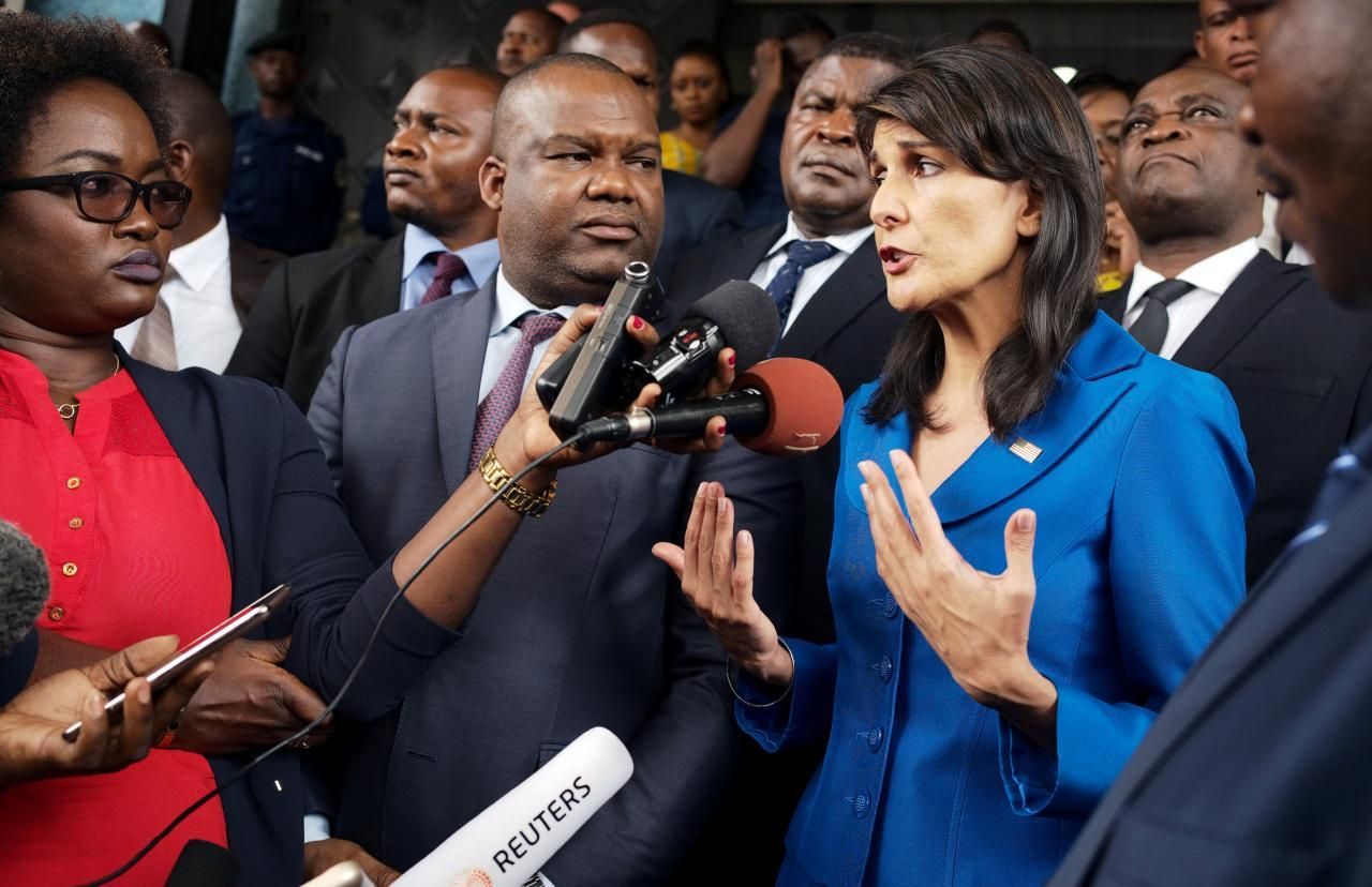 U.S. Ambassador to the United Nations Nikki Haley and President of Congo's electoral commission (CENI) Corneille Nangaa (C) addresses the media at the CENI headquarters in Gombe, Kinshasa, Democratic Republic of Congo, October 27, 2017. REUTERS/Robert Carrubba