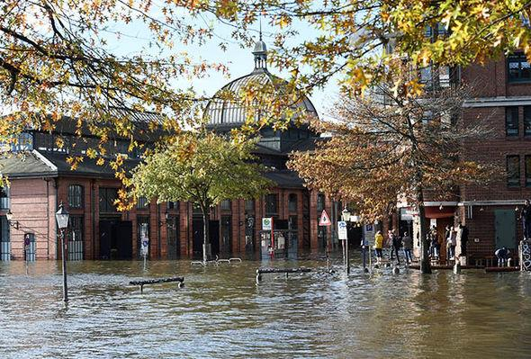 Storm Hewart has flooded the streets in Hamburg's fish market district