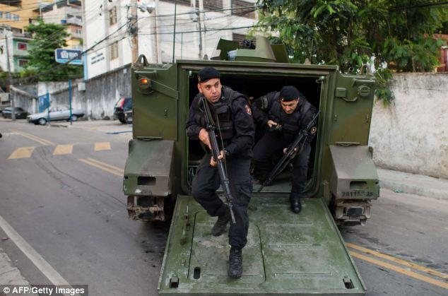 More than 1,000 Brazilian police officers swooped into slum neighborhoods in Rio de Janeiro at the crack of dawn this morning