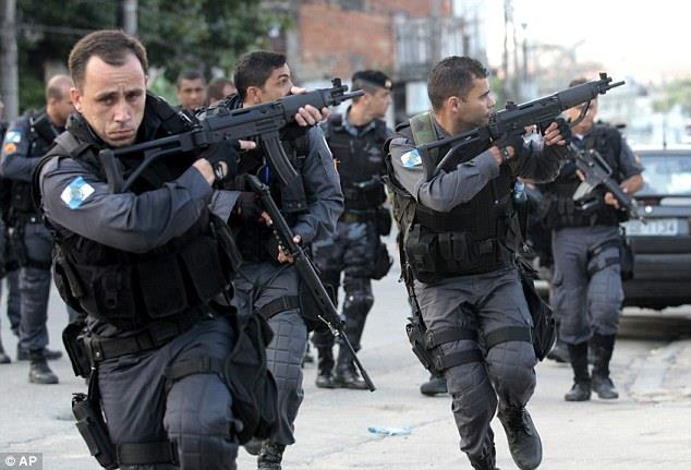 Police take position dPolice take position in what was the largest raid by Brazilian security forces