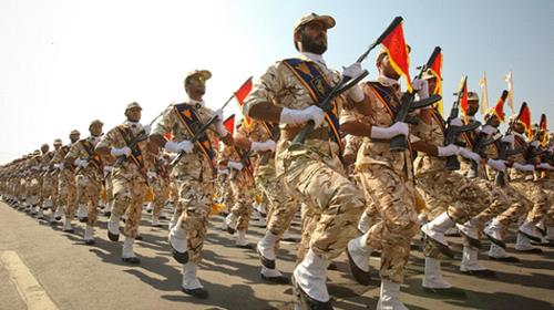 IRGC members march during a parade in Tehran, on September 22, 2011