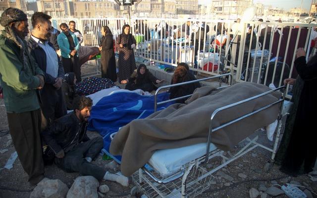 People react next to dead bodies following an earthquake in Sarpol-e Zahab county in Kermanshah, Iran Nov 13, 2017.