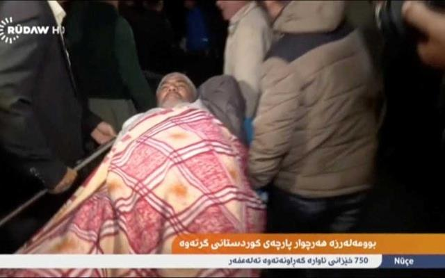 An injured man lies on a stretcher as he is taken to hospital after an earthquake at an unknown location in Iraq in this still image taken from video Nov 13, 2017. Rudaw TV