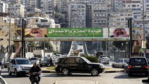 This November 10, 2017 photo shows a banner bearing images of Saudi King Salman and Mohammed bin Salman in Lebanese city of Tripoli.