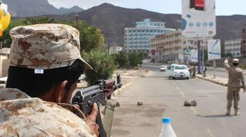 Security forces, loyal to Yemens President, man a checkpoint in the southern city