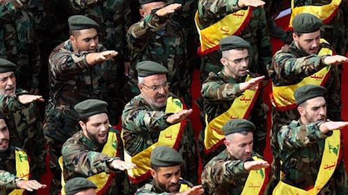 Members of Lebanons Shiite Hezbollah movement salute