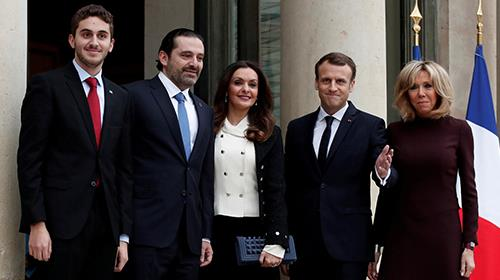 Hariri at the Elysee Palace with his wife and older son along with Macron and his wife.