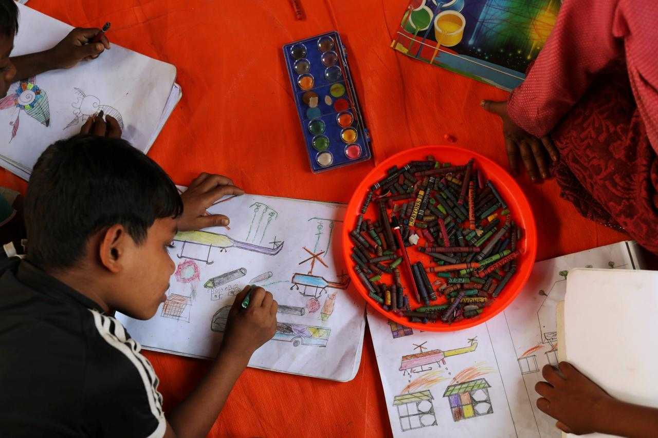 Rohingya refugee children spend time drawing at a UNICEF centre in Balukhali refugee camp near Cox's Bazar, Bangladesh, November 22, 2017