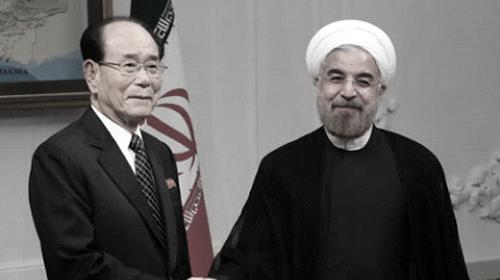 Hassan Rouhani, (R) shakes hands with North Koreas ceremonial head of state, Kim Yong-Nam, on his first official day in office, Aug. 3, 2013