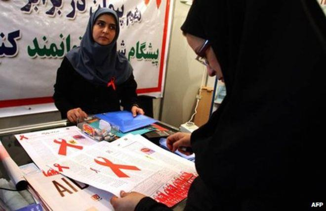 An Iranian woman reads a leaflet at an exhibition marking World Aids Day in Tehran