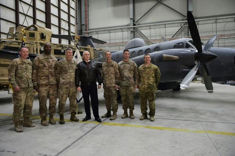 US Vice President Mike Pence poses with military leaders shortly after arriving at Bagram Air Field in Afghanistan on December 21, 2017