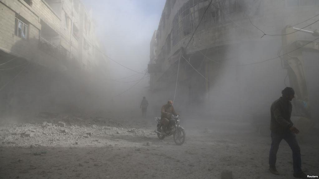 People are seen during shelling in the town of Hamoria, eastern Ghouta in Damascus, Syria, Dec. 3, 2017.