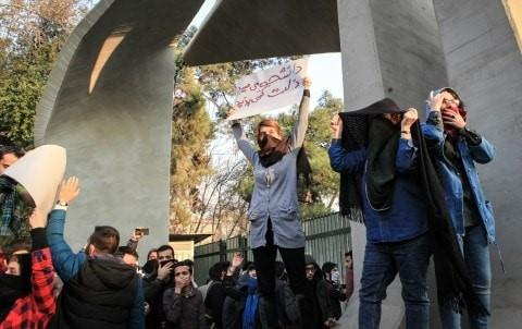 Students clash with police during an anti-government protest around the University of Tehran on Dec. 30