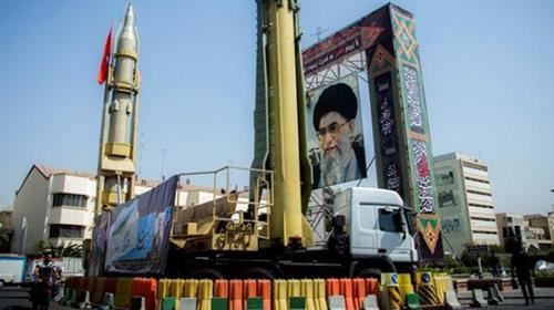 A display featuring missiles and a portrait of Khamenei is seen at Baharestan Square in Tehran