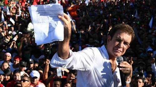 Leftist Salvador Nasralla has denounced President Juan Orlando Hernandez's bid for a second term as illegal