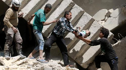 Volunteers and rescuers retrieve a baby from the rubble of a destroyed building after a reported airstrike on the rebel-held neighbourhood of al-Kalasa in Aleppo