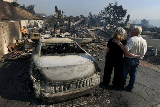 A couple's home was destroyed by wildfires in Ventura, Calif., on Tuesday.