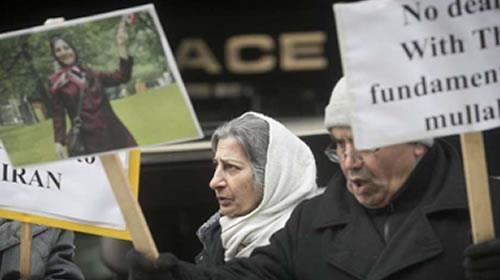 Roghayeh Azizi Mirmahaleh, centre, takes part in protest outside the federal immigration and refugee offices in Montreal Feb. 21, 2017. Mirmahaleh is to be deported to Iran Feb. 28.