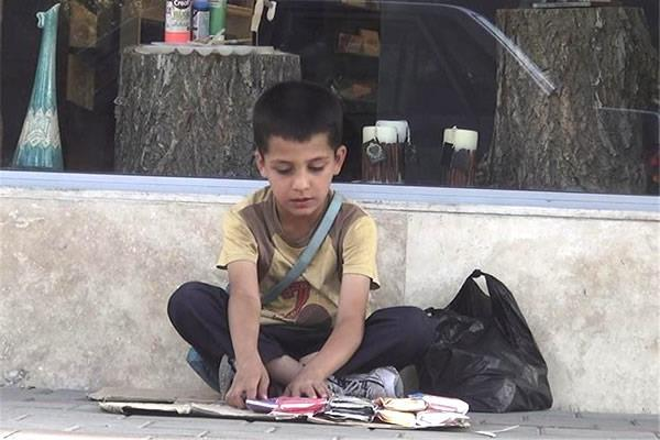 An Iranian child has to grow fast to learn the harshness of the life of povert