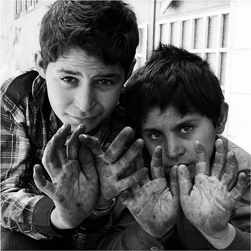 These are the hands of Iranian children that have fallen victims to injustice