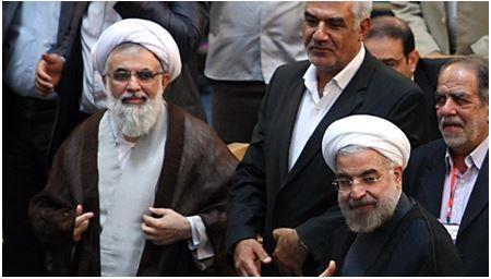 علی فلاحیان، در کنار حسن روحانی و برادرش حسین روحانی در مراسم تقدیر از فعالان ستاد انتخاباتی حسن روحانی