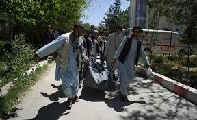 Afghan volunteers carrying the body of a resident killed in a car bomb attack to the Wazir Akbar Khan hospital in Kabul.