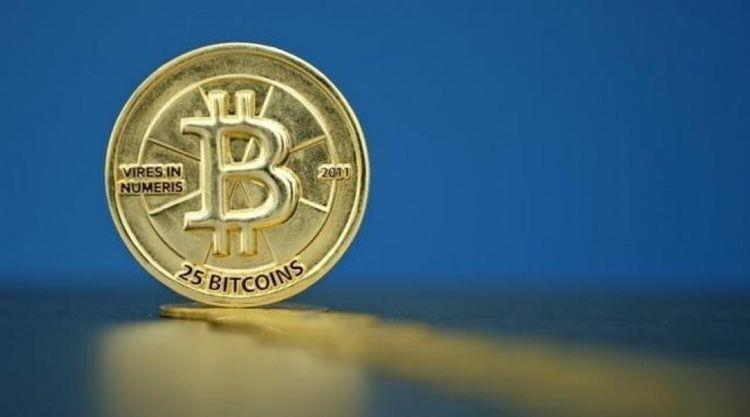 Bitcoin (virtual currency) coins are seen in an illustration picture taken at La Maison du Bitcoin in Paris, France