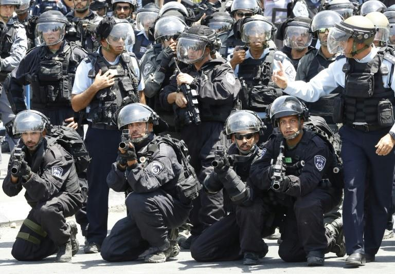 Israeli police hold stun grenades launchers following Friday noon prayers outside Jerusalem's Old City on July 28, 2017