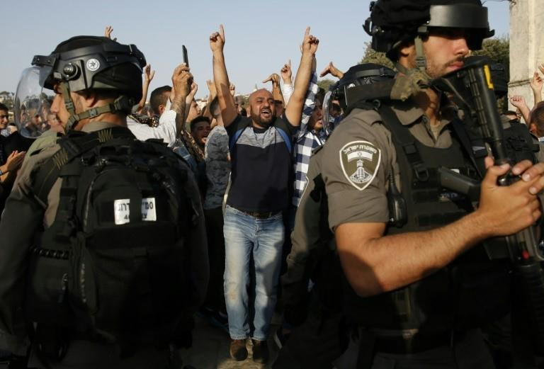A Palestinian shouts slogans at Israeli police at Jerusalem's Al-Aqsa mosque compound as clashes break out after the ending of a two-week Muslim boycott on July 27, 2017