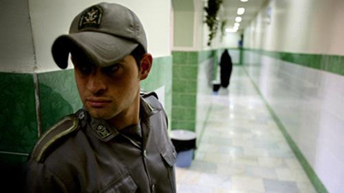 A prison guard stands along a corridor in Tehrans Evin prison June 13, 2006