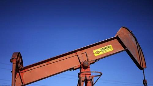 An oil well pump jack is seen at an oil field supply yard near Denver, Colorado February 2, 2015