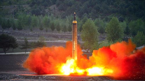 A photo released by North Korea's official news agency in May purporting to show the launch of a Hwasong-12 ballistic missil