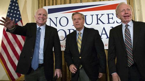 Sen. John McCain, R-Ariz., left, Sen. Lindsey Graham, R-S.C., center and former Sen. Joe Lieberman, I-Conn., right, at a town hall meeting
