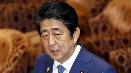 Japan PM Shinzo Abe sends ritual offering to war dead shrine on World War 2 surrender