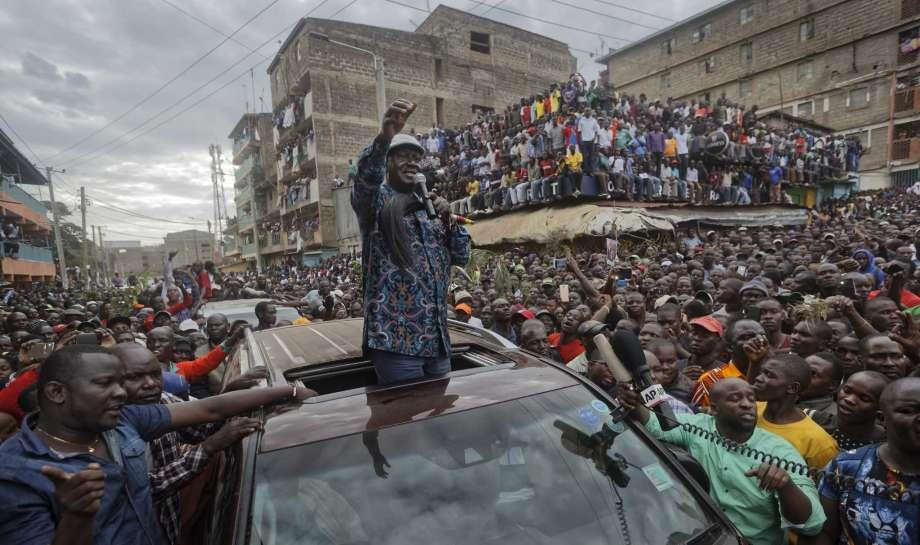 Kenyan opposition leader Raila Odinga gestures to thousands of supporters gathered in the Mathare area