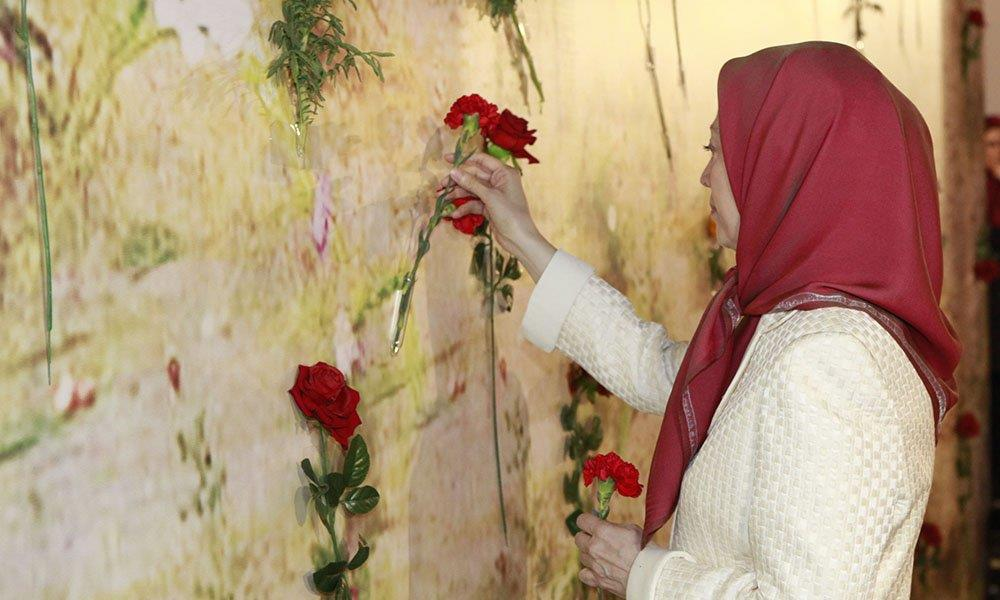 Mrayam Rajavi setting flowers at the memorial of the 1988 massacre of political prisoners in Iran