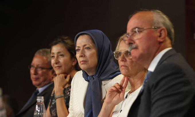 Maryam Rajavi and a number of dignitaries at a ceremoney marking the 29th anniversary of the 1988 massacre of political prisoner in Iran