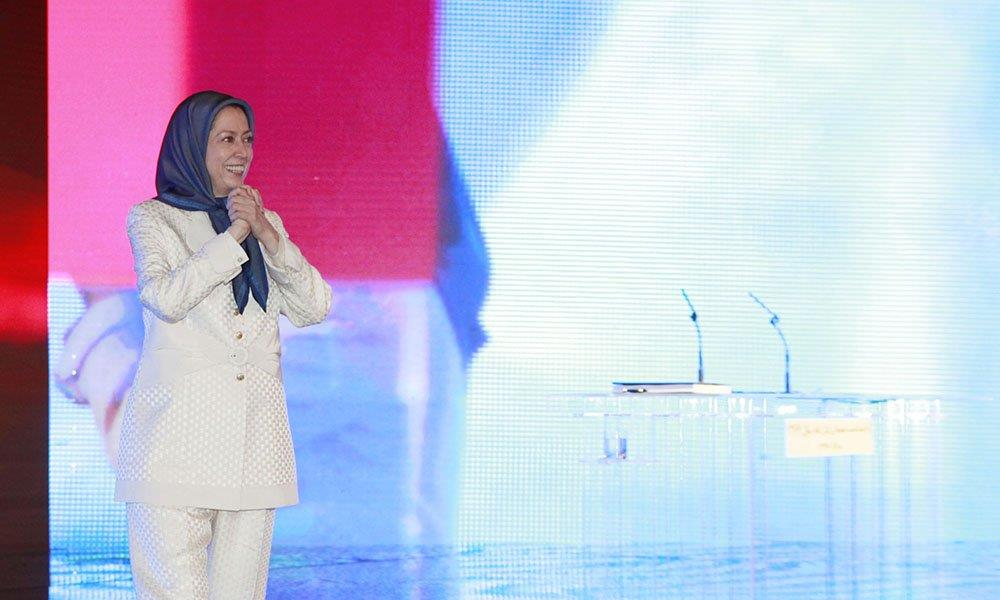 Maryam Rajavi gestures at the crowd of MEK after a speech on the anniversary of the 1988 massacre of 30,000 political prisoners in Iran