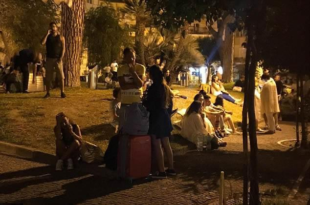 Locals and tourists were forced to wait in the street after the earthquake hit the island just off the coast of Italy
