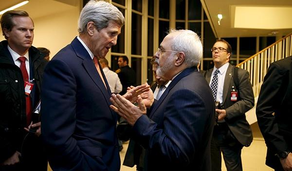 Secretary of State John Kerry talks with Iranian Foreign Minister Mohammad Javad Zarif after the International Atomic Energy Agency (IAEA) verified that Iran has met all conditions under the nuclear deal, in Vienna January 16, 2016.