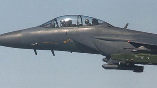 In this photo provided by South Korea Defense Ministry, a South Korean air force F-15K fighter jet
