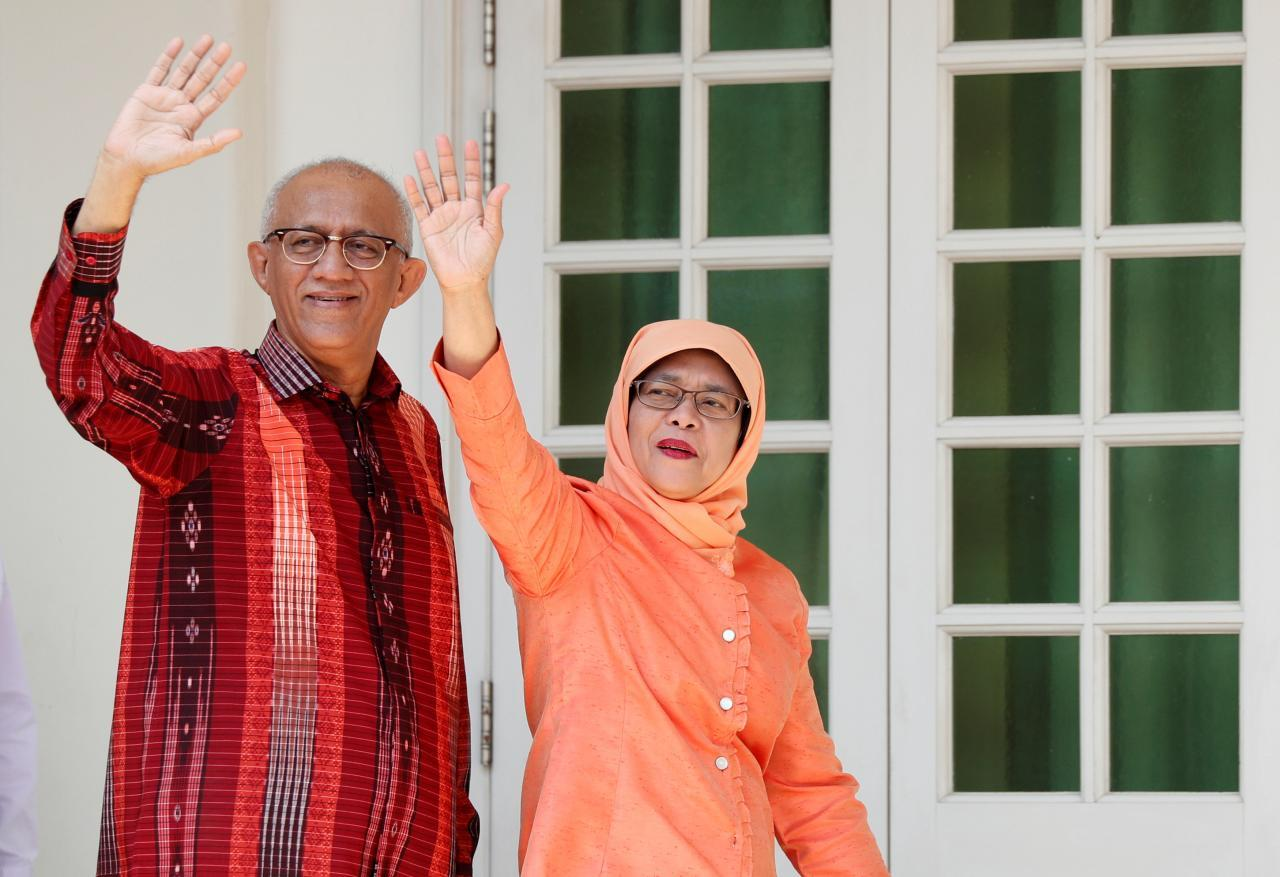 Singapore's President-elect Halimah Yacob and her husband Mohammed Abdullah Alhabshee address supporters before leaving the nomination centre in Singapore September 13, 2017