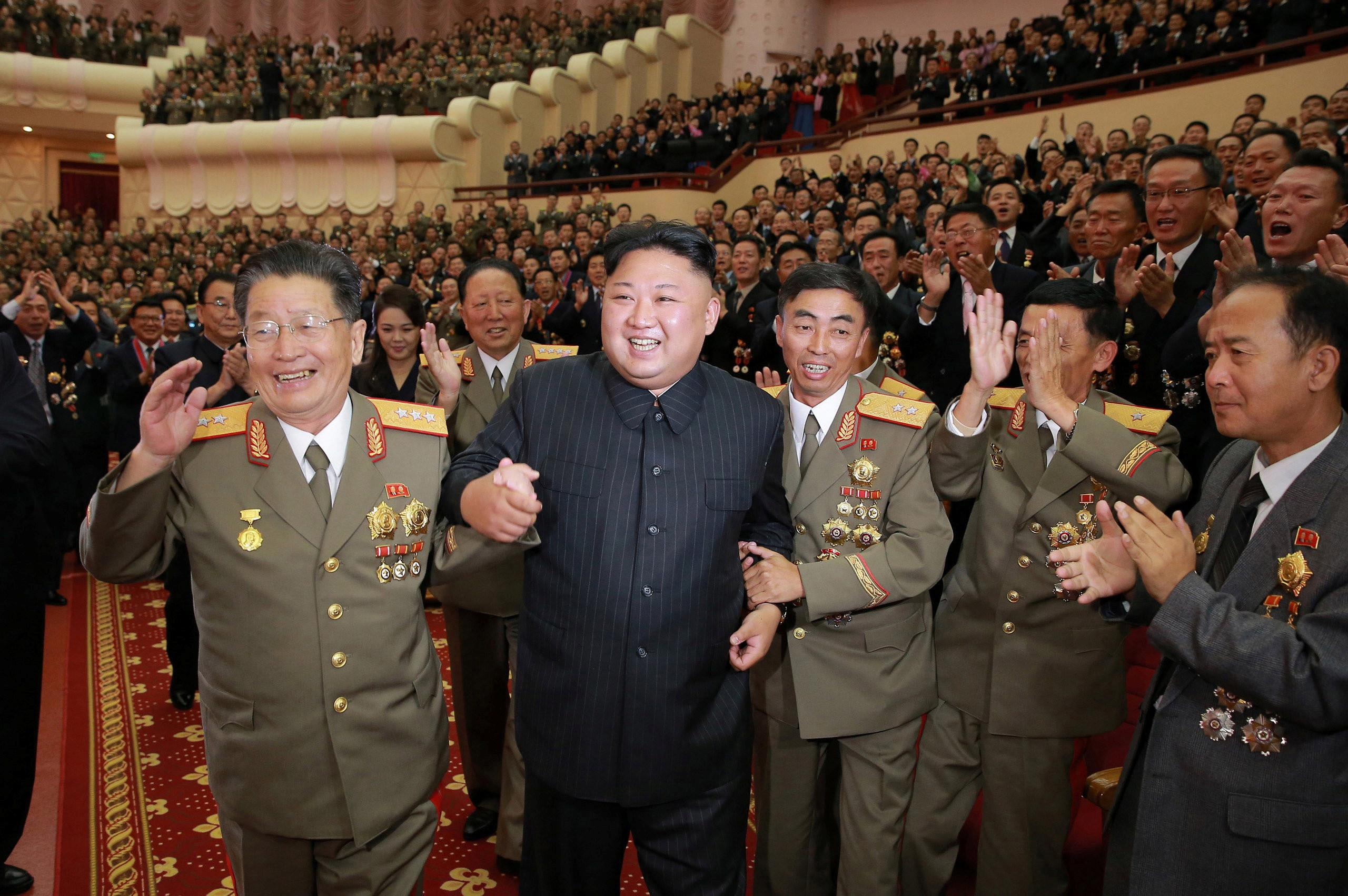 North Korean leader Kim Jong Un reacts during a celebration for nuclear scientists