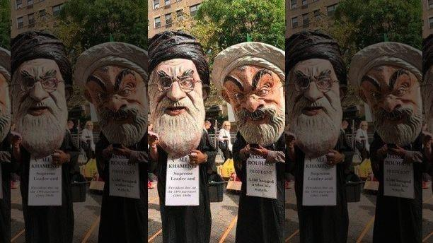 Iranian protestors gather outside the UN with caricature's of their President Rouhani