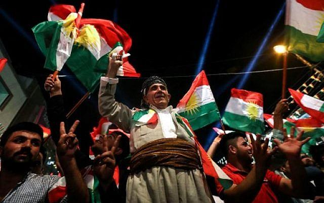 Iraqi Kurds celebrate while urging people to vote in the upcoming independence referendum in Arbil.