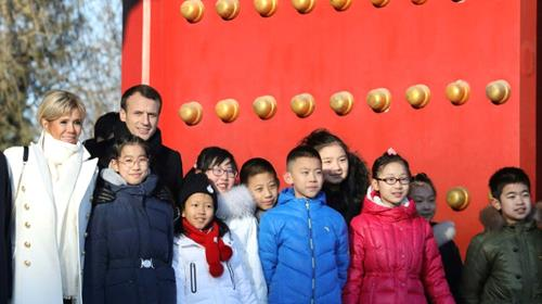 The Macrons were accompanied at the Forbidden City by students from the French international school