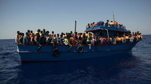 Migrants wait to be rescued in the Mediterranean Sea close to the Libyan coast on August 2, 2017