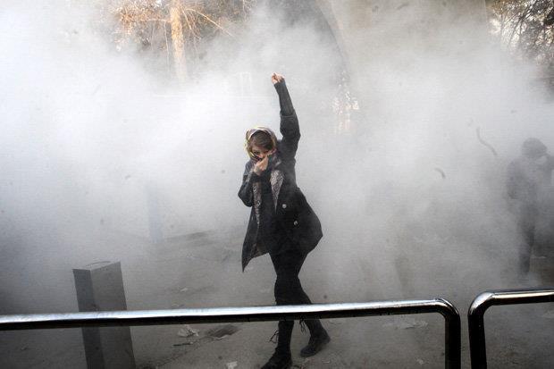 Iranian police tear gas protestors at Tehran University in violent scenes on Saturday